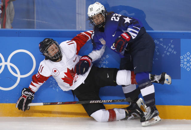 <p>Sidney Morin (23), of the United States, checks Jillian Saulnier (11), of Canada, during the second period of the women's gold medal hockey game at the 2018 Winter Olympics in Gangneung, South Korea, Thursday, Feb. 22, 2018. (AP Photo/Jae C. Hong) </p>