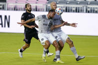 Inter Miami midfielder Rodolfo Pizarro, left, watches as Montreal defender Rudy Camacho, center, heads the ball during the first half of an MLS soccer match, Wednesday, May 12, 2021, in Fort Lauderdale, Fla. At right is Montreal defender Aljaz Struna. (AP Photo/Lynne Sladky)