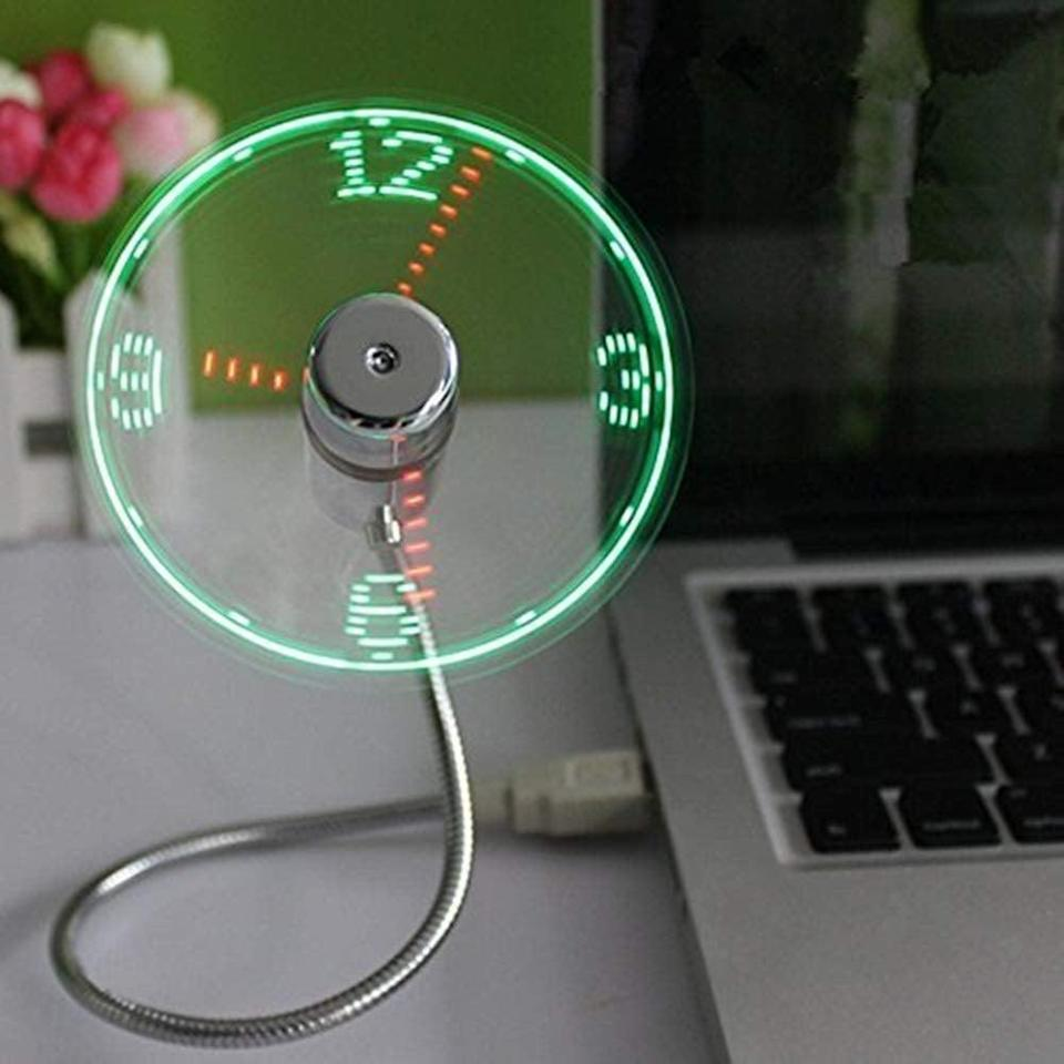 <p>This <span>OnetwoUSB LED Clock Fan </span> ($16, originally $25) will keep him cool.</p>