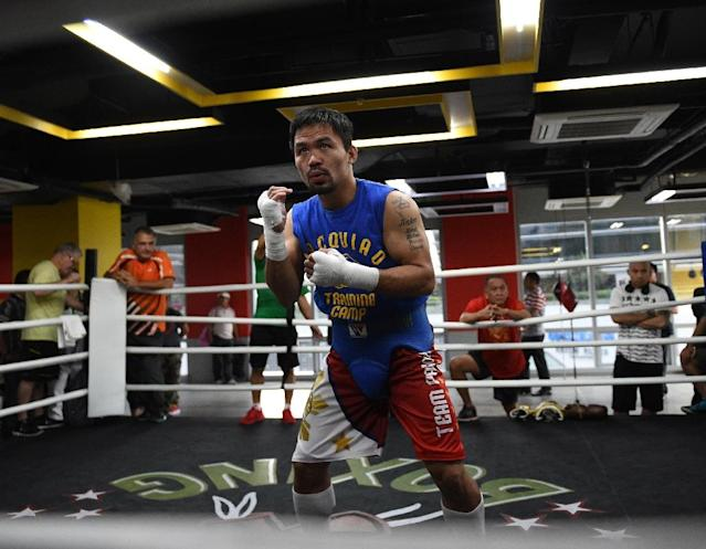 Philippine boxing icon Manny Pacquiao, 38, will face undefeated Australian Jeff Horn, 29, in Brisbane, Australia (AFP Photo/TED ALJIBE)
