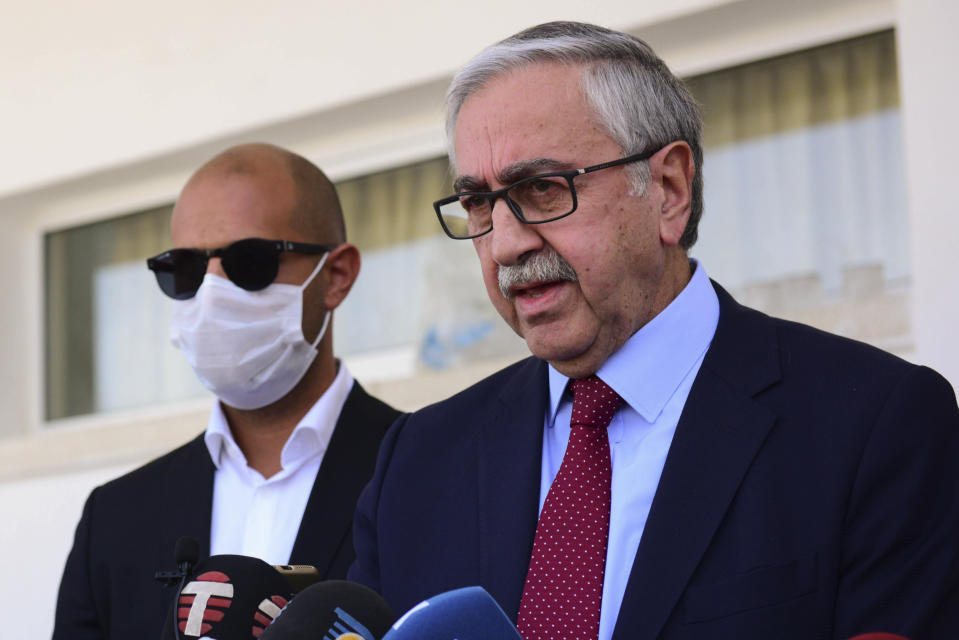 Turkish Cypriot leader and candidate Mustafa Akinci speak to the media after voting at a polling station in the Turkish occupied area in the north part of the divided capital Nicosia, Cyprus, Sunday, Oct. 18, 2020. Turkish Cypriots are voting in a leadership runoff to chose between an incumbent who pledges a course less bound by Turkey's dictates and a challenger who favors even closer ties to Ankara. (AP Photo/Nedim Enginsoy)