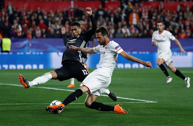 Soccer Football - Champions League Round of 16 First Leg - Sevilla vs Manchester United - Ramon Sanchez Pizjuan, Seville, Spain - February 21, 2018 Sevilla's Franco Vazquez in action with Manchester United's Chris Smalling REUTERS/Juan Medina