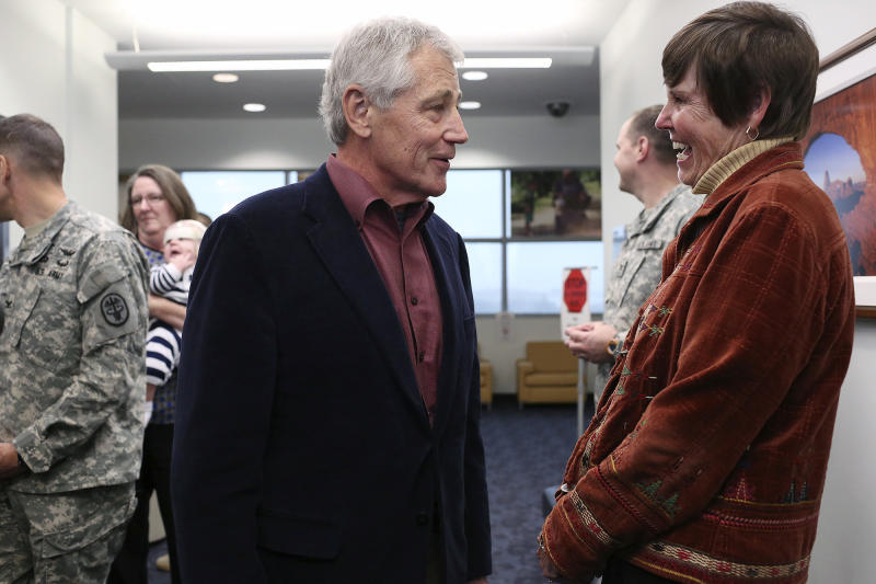 U.S. Secretary of Defense Chuck Hagel talks with retired Army Col. Rebecca Hooper, program manager for the Center for the Intrepid, after Hagel spoke to soldiers, veterans and staff at the center in San Antonio on Wednesday, Jan. 8, 2014. (AP Photo/The San Antonio Express-News, Lisa Krantz) RUMBO DE SAN ANTONIO OUT; NO SALES