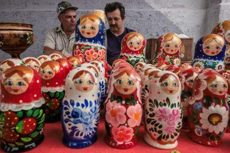 Men sell traditional dolls at a small market in Bor, Nizhny Novgorod, Russia July 1, 2018. REUTERS/Damir Sagolj