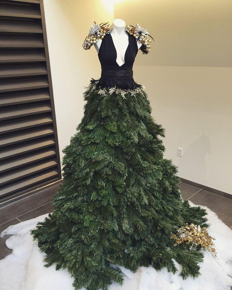 """<p>Exactly two weeks before Christmas Day, newly revamped retailer DressBarn shared this photo of a totally new kind of tree topper: Instead of the classic angel or star, why not use a mannequin torso and turn your X-mas tree into a ballgown?! According to <a href=""""https://www.facebook.com/dressbarn/photos/a.91902295543.99111.60577330543/10153219909875544/?type=3&theater"""" rel=""""nofollow noopener"""" target=""""_blank"""" data-ylk=""""slk:DressBarn's Facebook"""" class=""""link rapid-noclick-resp"""">DressBarn's Facebook</a>, the """"dress"""" was inspired by """"fashion icon Jennifer Lopez."""" It's no plunging Versace, but with a bit of tweaking (to make it wearable, that is), we can totally see if working for a televised holiday special.</p><p><br></p>"""