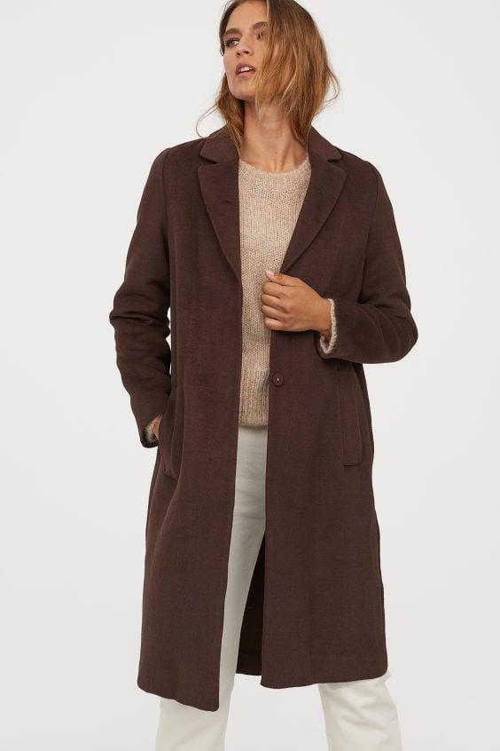 """<p>The dark shade of this <a href=""""https://www.popsugar.com/buy/HampM-Straight-cut-Coat-487237?p_name=H%26amp%3BM%20Straight-cut%20Coat&retailer=www2.hm.com&pid=487237&price=60&evar1=fab%3Aus&evar9=46575897&evar98=https%3A%2F%2Fwww.popsugar.com%2Ffashion%2Fphoto-gallery%2F46575897%2Fimage%2F46575915%2FHM-Straight-cut-Coat&list1=shopping%2Cfall%20fashion%2Ccoats%2Cfall%2Cwinter%2Couterwear%2Cwinter%20fashion&prop13=api&pdata=1"""" rel=""""nofollow"""" data-shoppable-link=""""1"""" target=""""_blank"""" class=""""ga-track"""" data-ga-category=""""Related"""" data-ga-label=""""https://www2.hm.com/en_us/productpage.0755361003.html"""" data-ga-action=""""In-Line Links"""">H&amp;M Straight-cut Coat</a> ($60) is so chic.</p>"""