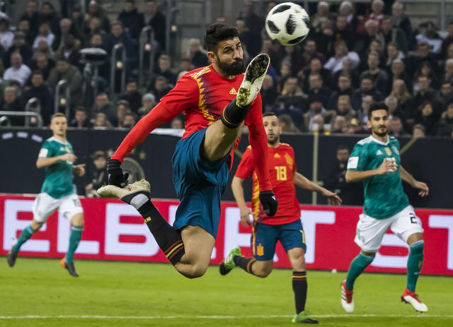Diego Costa leaps and lunges for a ball in a friendly between Spain and Germany. He makes our 2018 World Cup top 50, as do the three players in the background. (Getty)