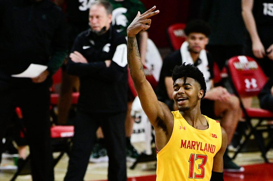 Maryland Terrapins guard Hakim Hart (13) reacts after making a 3-point shot as Michigan State Spartans head coach Tom Izzo walks down the sidelines during the second half Feb. 28, 2021, at Xfinity Center in College Park, Maryland.