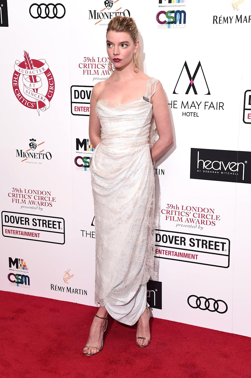 <p>Anya wore a Vivienne Westwood gown with her gold hair and makeup.</p>