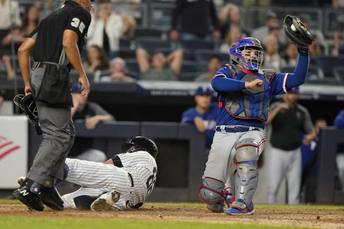 Texas Rangers catcher Jose Trevino tags out New York Yankees' Kyle Higashioka at home plate during the fifth inning of a baseball game Wednesday, Sept. 22, 2021, in New York. (AP Photo/Frank Franklin II)