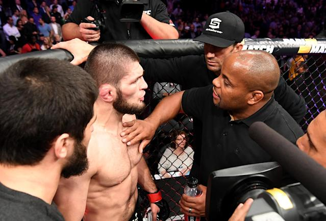(R-L) Daniel Cormier and Luke Rockhold talk to Khabib Nurmagomedov after a post-fight incident during the UFC 229 event inside T-Mobile Arena on Oct. 6, 2018 in Las Vegas. (Getty Images)