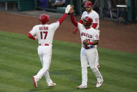Los Angeles Angels designated hitter Shohei Ohtani (17) and Justin Upton (10) celebrate after scoring off of a double hit by Anthony Rendon during the third inning of a baseball game against the Kansas City Royals Wednesday, June 9, 2021, in Los Angeles, Calif. (AP Photo/Ashley Landis)