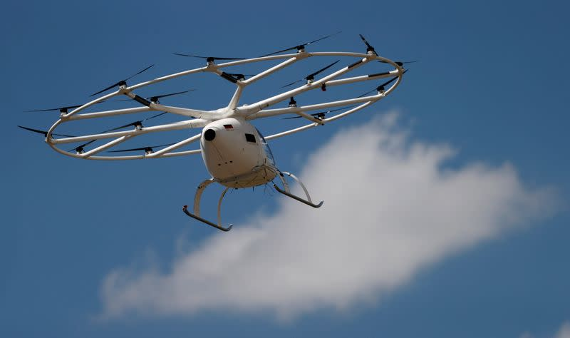 A Volocopter air-taxi performs a flight over Le Bourget airport