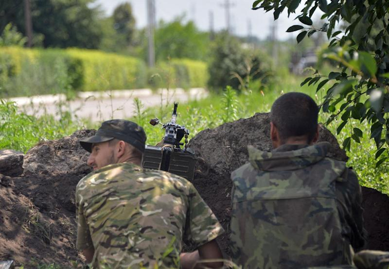 Ukrainian servicemen sit in the position as they guard in the small eastern city of Seversk on July 12, 2014, a day after the city was freed from pro-Russian militants (AFP Photo/Genya Savilov)
