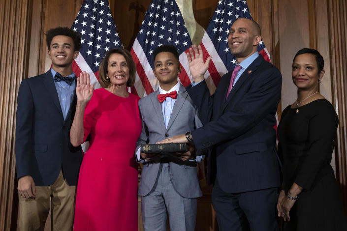 Speaker of the House Nancy Pelosi (2nd-L) performs the ceremonial swearing-in with US House Representative Hakeem Jeffries (2nd-R), D-NY,  and his family at the start of the 116th Congress at the US Capitol in Washington, DC, January 3, 2019. (Alex Edelman/AFP via Getty Images)