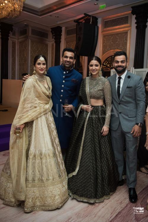 "<p>At the reception last evening, <a rel=""nofollow"" href=""https://www.pinkvilla.com/celebrity/anushka-sharma"" title=""Anushka Sharma"">Anushka Sharma</a> and Virat Kohli who are quite close to Sagarika and Zaheer made a stunning entry. They posed for photos with the newlyweds and grooved to Bollywood tracks. We saw videos in which Virat can be seen dancing with lady-love Anushka Sharma. </p><p>Recommended Read: <a rel=""nofollow"" href=""https://www.pinkvilla.com/entertainment/news/watch-virat-kohli-dances-dream-anushka-sharma-zaheer-khan-and-sagarika-ghatges-wedding-reception-392292#utm_source=yahoo&utm_medium=referral&utm_content=yahoomovies""> WATCH: Virat Kohli dances like a dream for Anushka Sharma at Zaheer Khan and Sagarika Ghatge's wedding reception </a></p><p>Incidentally, Anushka and Sagarika both donned Sabyasachi lehengas. Both the couples posed for a picture and looked absolutely regal.</p><p>Sushmita Sen, Bobby Deol, Suneil Shetty, Raj and Uddhav Thackery also attended the reception. Check out the photos! </p>"