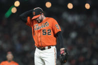 San Francisco Giants pitcher Dominic Leone reacts after walking Pittsburgh Pirates' Adam Frazier with the bases loaded during the seventh inning of a baseball game in San Francisco, Friday, July 23, 2021. (AP Photo/Jeff Chiu)