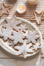 "<p>Dust these delicious pecan cookies with powdered sugar to make them look like actual snowflakes.</p><p><strong><a href=""https://www.countryliving.com/food-drinks/a29643034/pecan-snowflake-cookies-recipe/"" rel=""nofollow noopener"" target=""_blank"" data-ylk=""slk:Get the recipe"" class=""link rapid-noclick-resp"">Get the recipe</a>.</strong></p><p><strong><a class=""link rapid-noclick-resp"" href=""https://www.amazon.com/Ann-Clark-Cookie-Cutters-Snowflake/dp/B07NJJFZ3W/ref=sr_1_1_sspa?tag=syn-yahoo-20&ascsubtag=%5Bartid%7C10050.g.34553078%5Bsrc%7Cyahoo-us"" rel=""nofollow noopener"" target=""_blank"" data-ylk=""slk:SHOP SNOWFLAKE COOKIE CUTTERS"">SHOP SNOWFLAKE COOKIE CUTTERS</a><br></strong></p>"