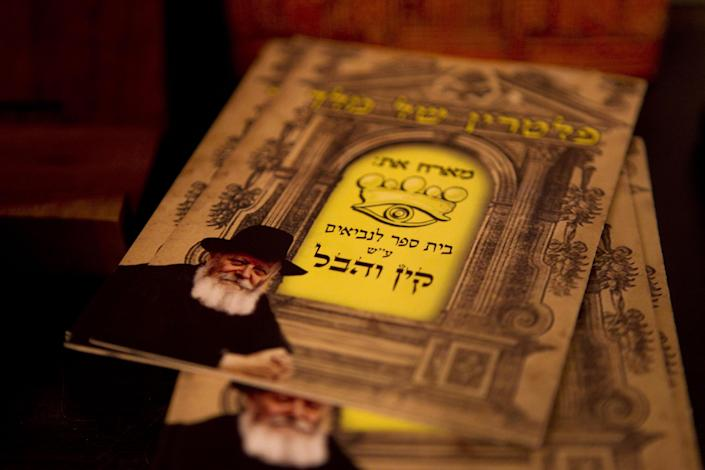 In this photo taken on Tuesday, Dec. 4, 2012, brochures for the Cain and Abel School for Prophets are displayed in Tel Aviv, Israel. Instead of long beards and robes, they wear track suits and T-shirts. Their tablets are electronic, not hewn of stone, and they hold smartphones, not staffs. They may not look the part, but this ragtag group of Israelis is training to become the next generation of prophets. For just 200 shekels ($53) and in only 40 short classes, anyone can become a certified, modern-day soothsayer at the Cain and Abel School for Prophets.(AP Photo/Ariel Schalit)