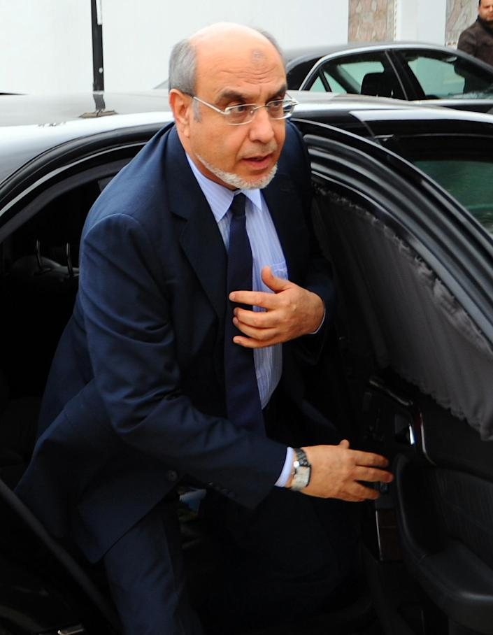 Tunisian Prime Minister Hamadi Jebali, arrives for a meeting with representatives of all Tunisian political parties, to see if there is sufficient support for his solution to end the country's ongoing political crisis in Carthage, outside Tunis, Monday, Feb. 18, 2013. Jebali's initiative, while supported by the opposition, puts him on a collision course with the moderate Islamist Ennahda Party, which dominates the government. (AP Photo/Hassene Dridi)