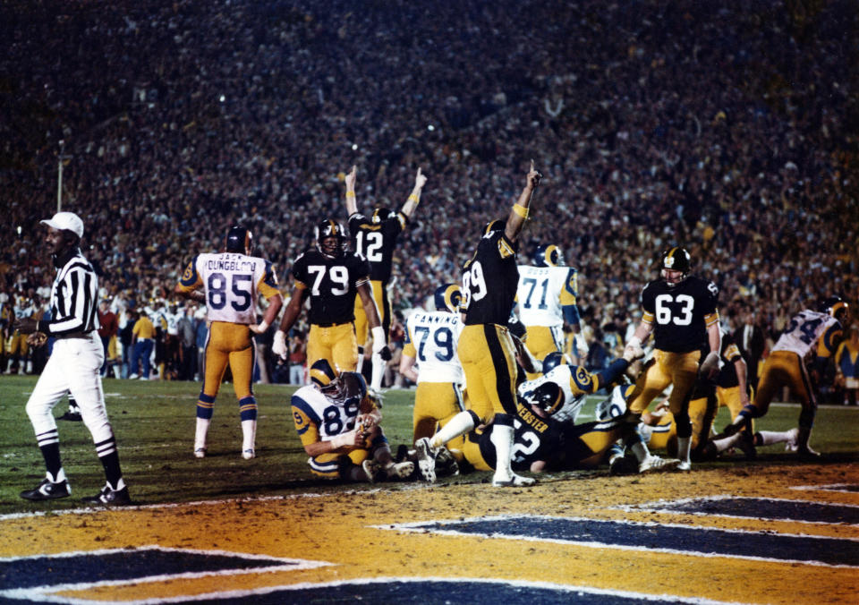 Steelers quarterback Terry Bradshaw (12), along with other teammates, celebrate after scoring a touchdown in Super Bowl XIV against the Los Angeles Rams on Jan. 20, 1980 at the Rose Bowl in Pasadena, California. (Photo by Robert Riger/Getty Images)