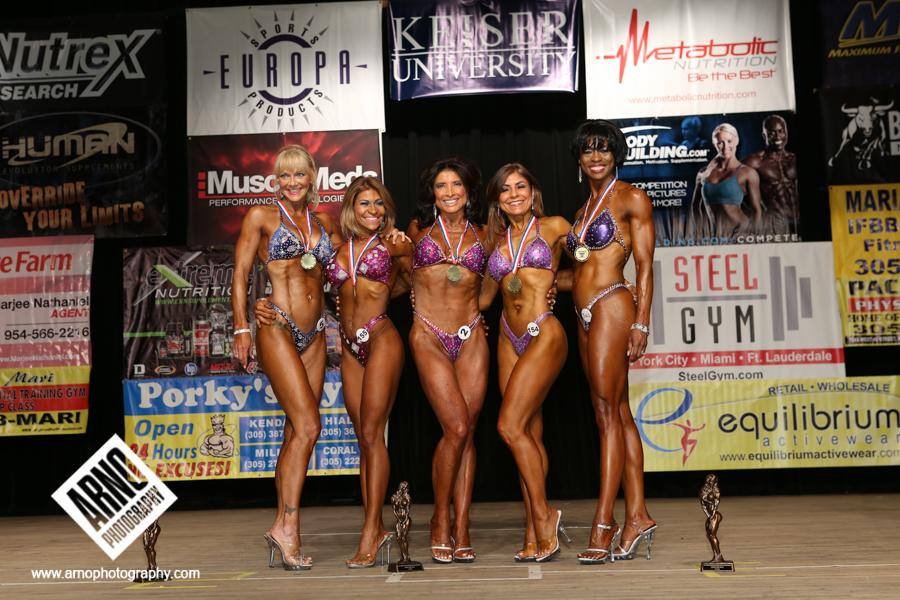 "<div class=""caption-credit""> Photo by: Arno Photography</div><div class=""caption-title""></div>Competitors in the over-50 figure category. ""The women in this category have to be muscular, defined, and fit but still have a soft shape,"" says Potter."