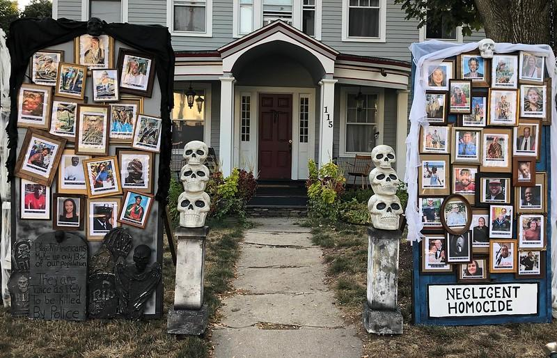 """The """"Halloween House"""" displays photos of people who have died from COVID-19 or at the hands of police. (Photo: Matt Warshauer)"""