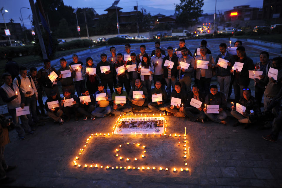 Nepali journalists and photojournalists lit candles to pay tribute to the journalists killed in Kabul attack at Kathmandu, Nepal on wednesday, May 02, 2018. The program was jointly oraganized by Photojournalist club Nepal and Federation of Nepali Journalist (FNJ). (Photo by Narayan Maharjan/NurPhoto via Getty Images)