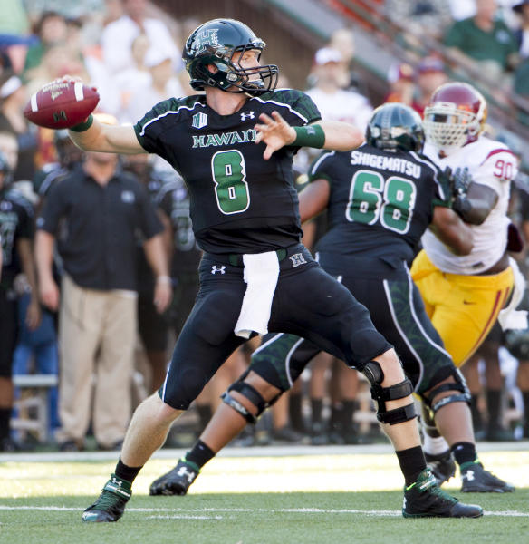 Hawaii quarterback Taylor Graham (8) drops back to pass as offensive linesman Sean Shigematsu (68) blocks Southern California defensive end George Uko (90) during the first quarter of an NCAA college football game Thursday, Aug. 29, 2013, in Honolulu. (AP Photo/Eugene Tanner)