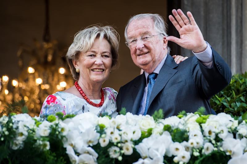 Belgium's King Albert II and Queen Paola wave to the crowd as they stand on the balcony of the City Hall in Liege, Belgium, during the last day of their 3-day farewell tour on Friday July 19, 2013. In a fractious nation ever more divided by language, it may be too much to ask for a royal to hold it all together. Belgian King Albert on Sunday hands over the throne to his son Philippe in a day-long ceremony, but the transition from a trusted monarch to a disputed successor gives Belgians yet another subject to disagree on. (AP Photo/Geert Vanden Wijngaert)