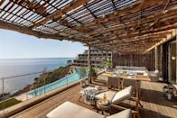 """<p>As the party capital of the world, <a href=""""https://www.redonline.co.uk/travel/inspiration/a26109513/cheap-easter-holidays/"""" rel=""""nofollow noopener"""" target=""""_blank"""" data-ylk=""""slk:Ibiza"""" class=""""link rapid-noclick-resp"""">Ibiza</a> is largely synonymous with megaclubs and A-lister beach parties, but scratch the surface and you'll find a real boho beauty, which you'll want to experience from the best hotels in Ibiza.<br></p><p>Little over a two-hour flight from the UK, Ibiza is an easy island to explore for a weekend, a week or even longer. With a dramatic coastline dotted with pine forests and unspoilt sandy coves, many come to embrace the island's spiritual, bohemian side with beachfront <a href=""""https://www.redonline.co.uk/travel/inspiration/g25734483/best-wellness-breaks-around-world/"""" rel=""""nofollow noopener"""" target=""""_blank"""" data-ylk=""""slk:yoga retreat"""" class=""""link rapid-noclick-resp"""">yoga retreat</a>, sunset salutations or just a wander around the hippie markets. </p><p><a class=""""link rapid-noclick-resp"""" href=""""https://www.booking.com/region/es/ibiza.en-gb.html?aid=2070929&label=ibiza-hotels"""" rel=""""nofollow noopener"""" target=""""_blank"""" data-ylk=""""slk:BEST HOTELS IN IBIZA"""">BEST HOTELS IN IBIZA</a></p><p>Rippled with orange, lemon and almond groves, whitewashed chapels and rustic fincas-turned-agroturismos, Ibiza's lush interior is just as pretty, as any influencer's Insta reel will tell you. </p><p>While taxis are aplenty, why not have some fun and hire a colourful 2CV or a Mini Moke to buzz around the island beaches. And Ibiza is not a cultural abyss either. Take a walking tour around Dalt Vila, the fortified old town which dates back to Phoenician times or see Time and Space by Australian artist, Andrew Rogers, whose solar clock installation of 13 basalt columns is perched on the cliffs at Cala Llentia. </p><p>Of course, many also come for the inimitable nightlife...</p><p>However you plan on spending your time on the White Isle, you'll want to check into the most styl"""
