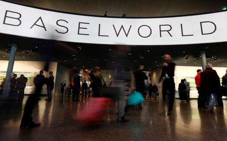 FILE PHOTO: Visitors arrive at the Baselworld watch and jewellery fair in Basel, Switzerland March 17, 2016.  REUTERS/Ruben Sprich/File Photo