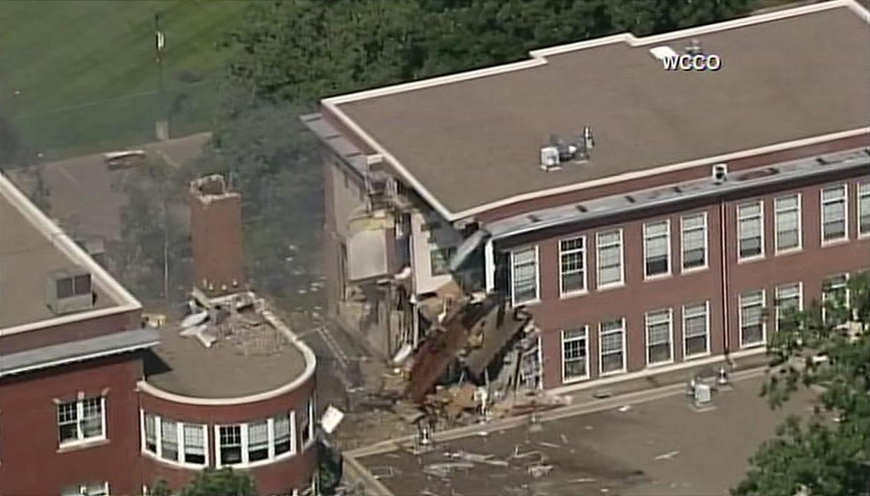 <p>Multiple people are reportedly trapped underneath a collapsed building that may have been caused by a blast at a Minneapolis school. (WCCO 4 News) </p>