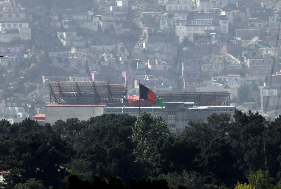 FILE - The Afghan flag flies atop the presidential palace in Kabul, Afghanistan, Tuesday, Aug. 17, 2021. On Friday, Aug. 20, 2021, The Associated Press reported on a photo circulating online that was digitally altered to make it appear that the Taliban flag was flying on the tower of the palace in Kabul on Sunday, Aug. 15, 2021. (AP Photo/Rahmat Gul, File)