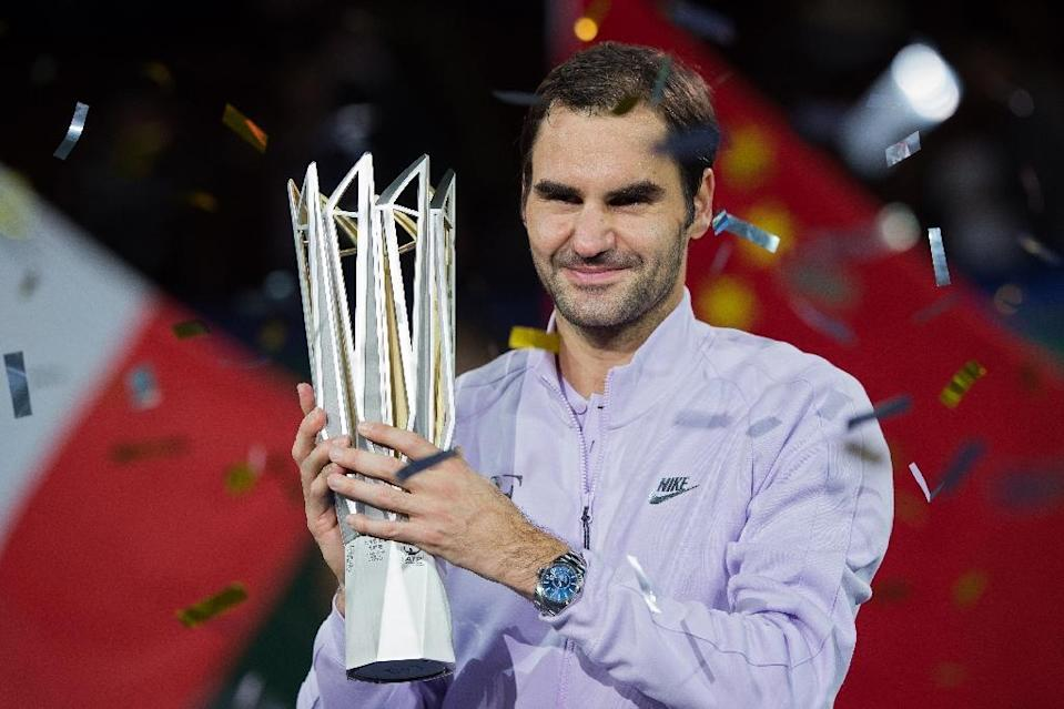 Roger Federer holds the trophy after winning a second Shanghai Masters crown -- and a sixth title in 2017. (AFP Photo/Nicolas ASFOURI)
