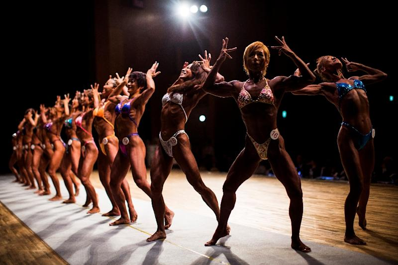 Female bodybuilders pose during the Japan bodybuilding championships in Tokyo (AFP Photo/Behrouz MEHRI)