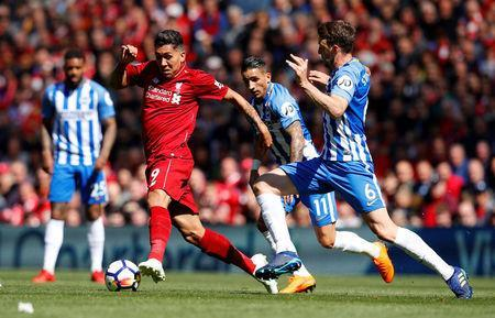Soccer Football - Premier League - Liverpool vs Brighton & Hove Albion - Anfield, Liverpool, Britain - May 13, 2018 Liverpool's Roberto Firmino in action with Brighton's Anthony Knockaert and Dale Stephens REUTERS/Phil Noble