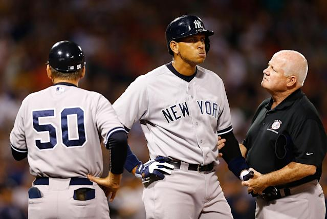 BOSTON, MA - AUGUST 18: Alex Rodriguez #13 of the New York Yankees is tended to by a trainer at first base after being hit by a pitch in the 2nd inning against the Boston Red Sox during the game on August 18, 2013 at Fenway Park in Boston, Massachusetts. Both benches were immediately warned following the hit-by-pitch. (Photo by Jared Wickerham/Getty Images)