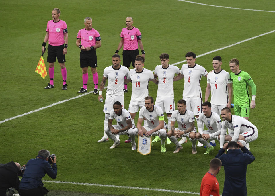 England players pose ahead of the Euro 2020 final soccer match between Italy and England at Wembley stadium in London, Sunday, July 11, 2021. (Facundo Arrizabalaga/Pool via AP)
