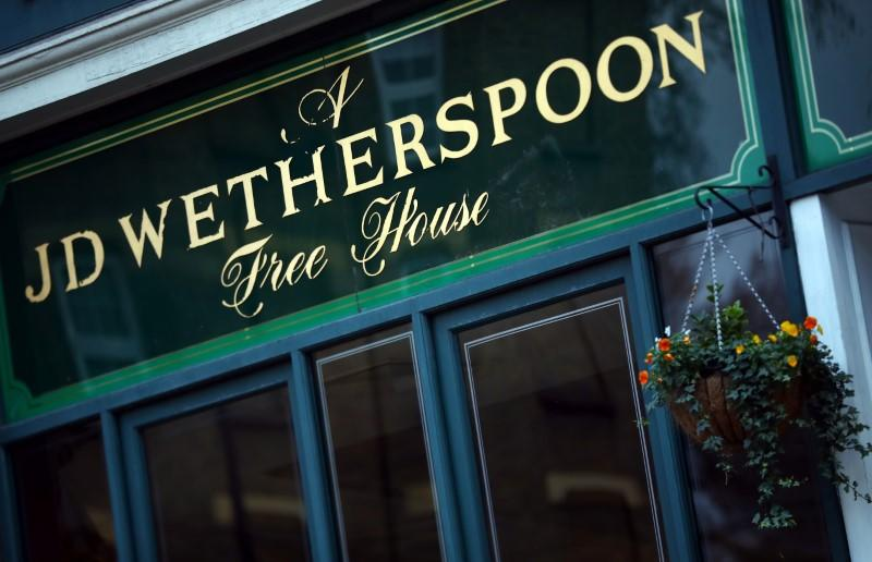 UK pubs operator Wetherspoon says in favour of staying open despite virus