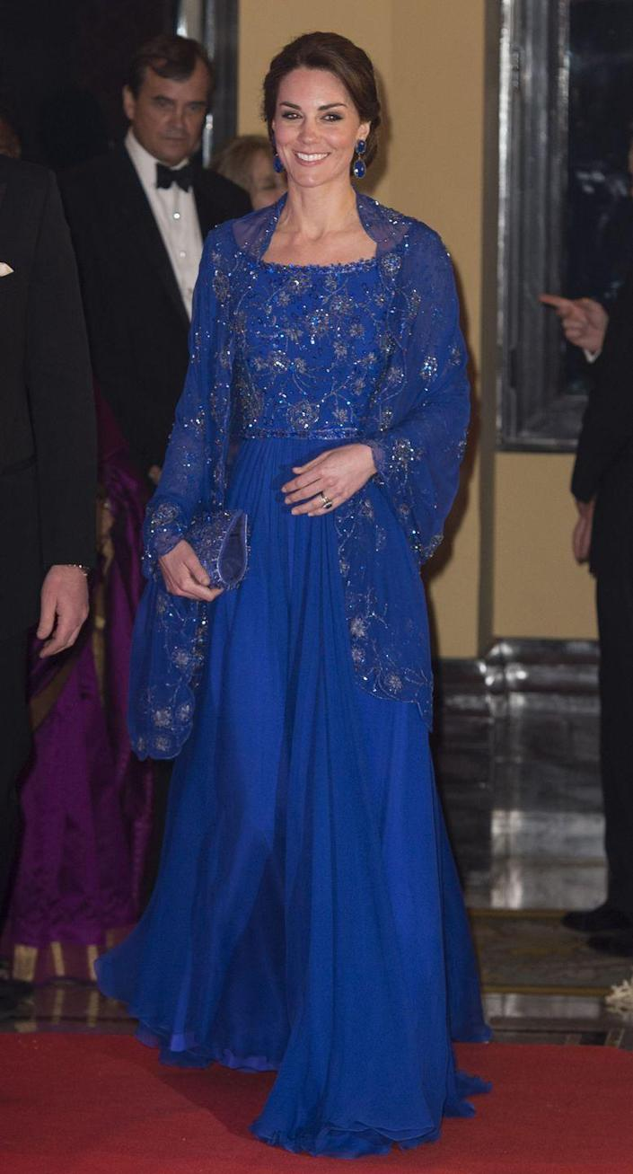 <p>In April 2016, Prince William and Duchess Kate went on a royal tour of India, where the Duchess wore this royal blue look by Jenny Packham. </p>