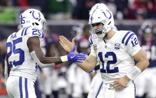Indianapolis Colts quarterback Andrew Luck (12) celebrates with running back Marlon Mack (25) after securing a win against the Houston Texans in the playoffs last season. (AP)