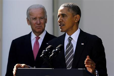Biden stands with Obama as he announces Johnson to be his nominee for Secretary of Homeland Security, in the Rose Garden of the White House in Washington