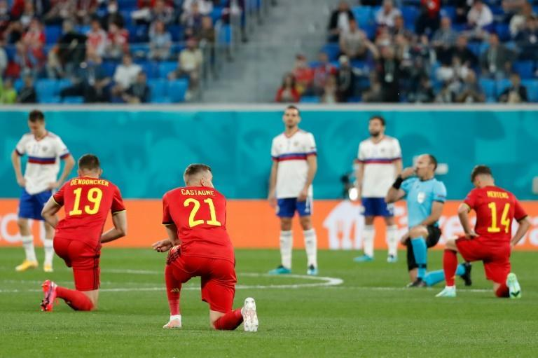 Belgium's players and the referee take a knee before Saturday's Euro 2020 match against Russia in St Petersburg