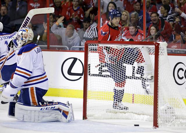Washington Capitals center Brooks Laich (21) celebrates his goal pat Edmonton Oilers goalie Jason LaBarbera (1) in the first period of an NHL hockey game, Monday, Oct. 14, 2013, in Washington . (AP Photo/Alex Brandon)