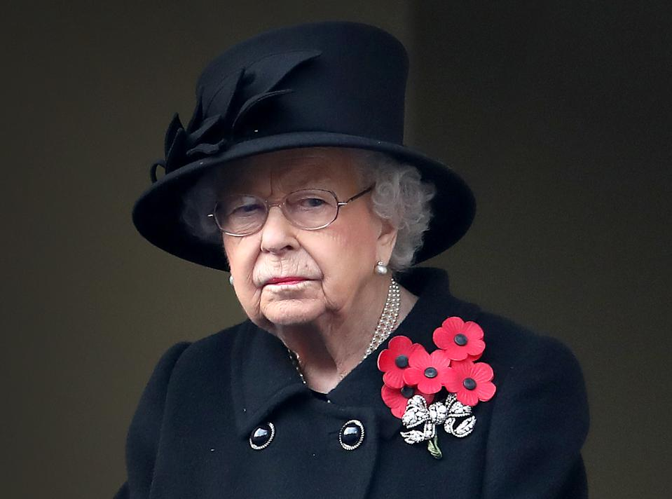 LONDON, ENGLAND - NOVEMBER 08: Queen Elizabeth II looks on during the Service of Remembrance at the Cenotaph at The Cenotaph on November 08, 2020 in London, England. Remembrance Sunday services are still able to go ahead despite the covid-19 measures in place across the various nations of the UK. Each country has issued guidelines to ensure the safety of those taking part. (Photo by Chris Jackson/Getty Images)