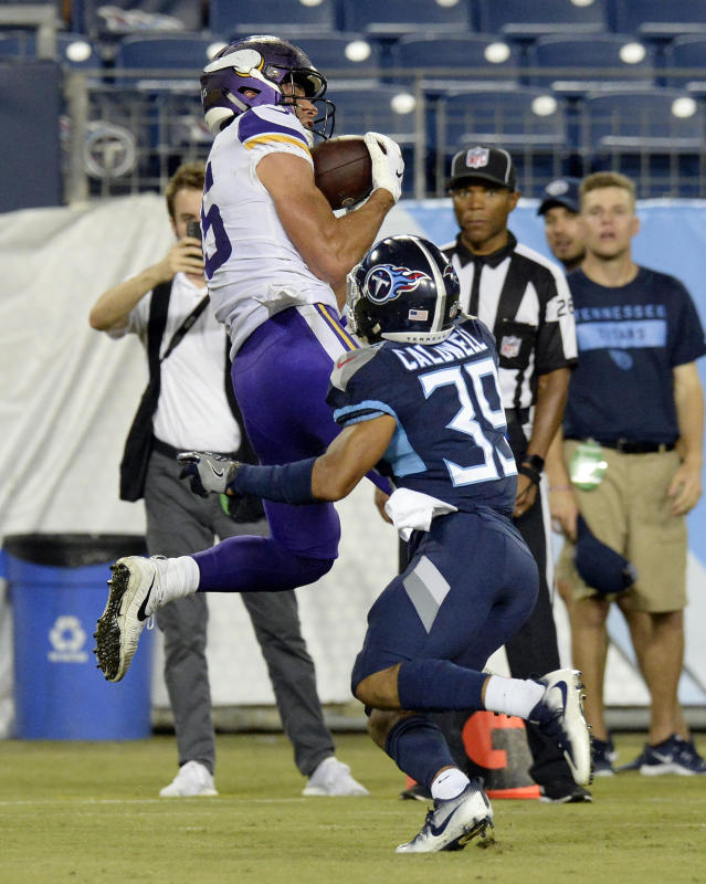 Minnesota Vikings wide receiver Brandon Zylstra (15) catches a 24-yard touchdown pass as he is defended by Tennessee Titans cornerback Trey Caldwell (39) in the second half of a preseason NFL football game Thursday, Aug. 30, 2018, in Nashville, Tenn. (AP Photo/Mark Zaleski)