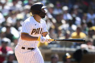 San Diego Padres' Eric Hosmer watches his hit against the Oakland Athletics in the sixth inning of a baseball game Wednesday, July 28, 2021, in San Diego. (AP Photo/Derrick Tuskan)