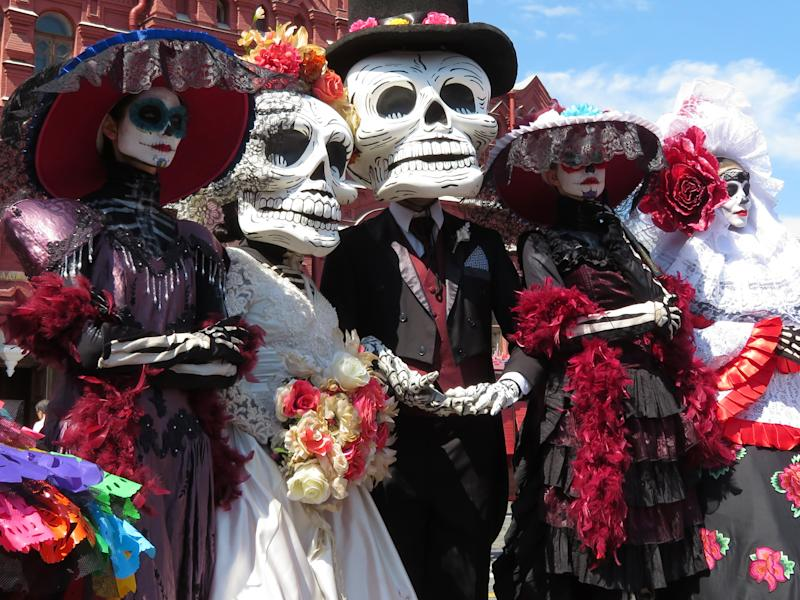 Moscow, Russia - September 2018: People in death masks and skeleton costumes during street performance in style of traditional Mexican holiday Dia de los Muertos