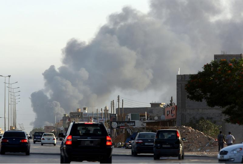 Smoke billows from an area near Tripoli's international airport during fighting between rival factions on July 24, 2014 (AFP Photo/Mahmud Turkia)